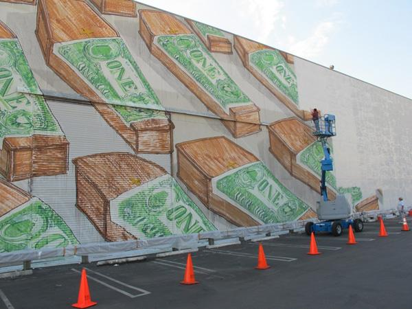 Il graffito realizzato da Blu in una sola notte sul murodi una fabbrica di Los Angeles negli Usa